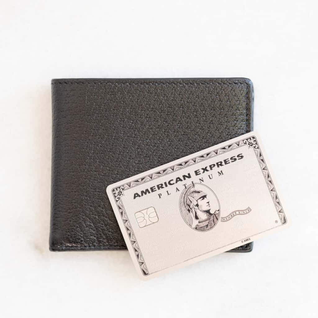 American Express Platinum card on a black leather wallet.