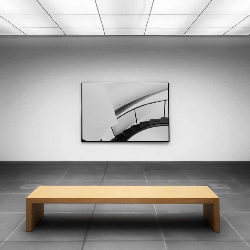 Art gallery with a wooden bench.