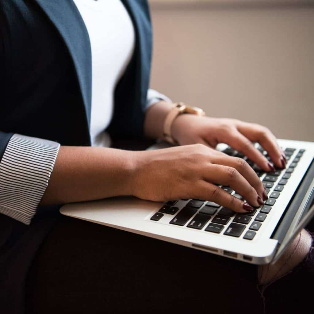 Businesswoman typing on a laptop.