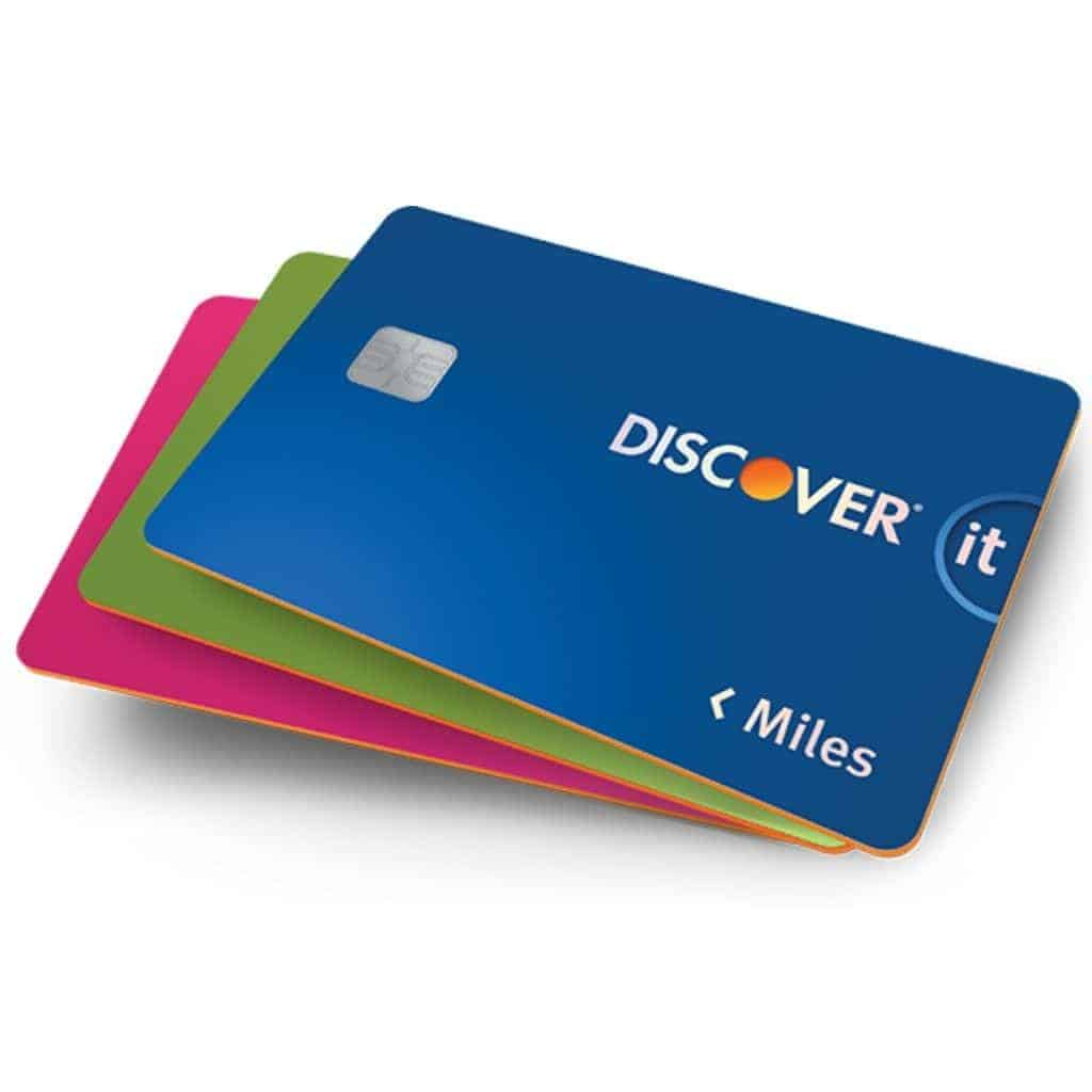 Stack of three Discover Miles credit cards.