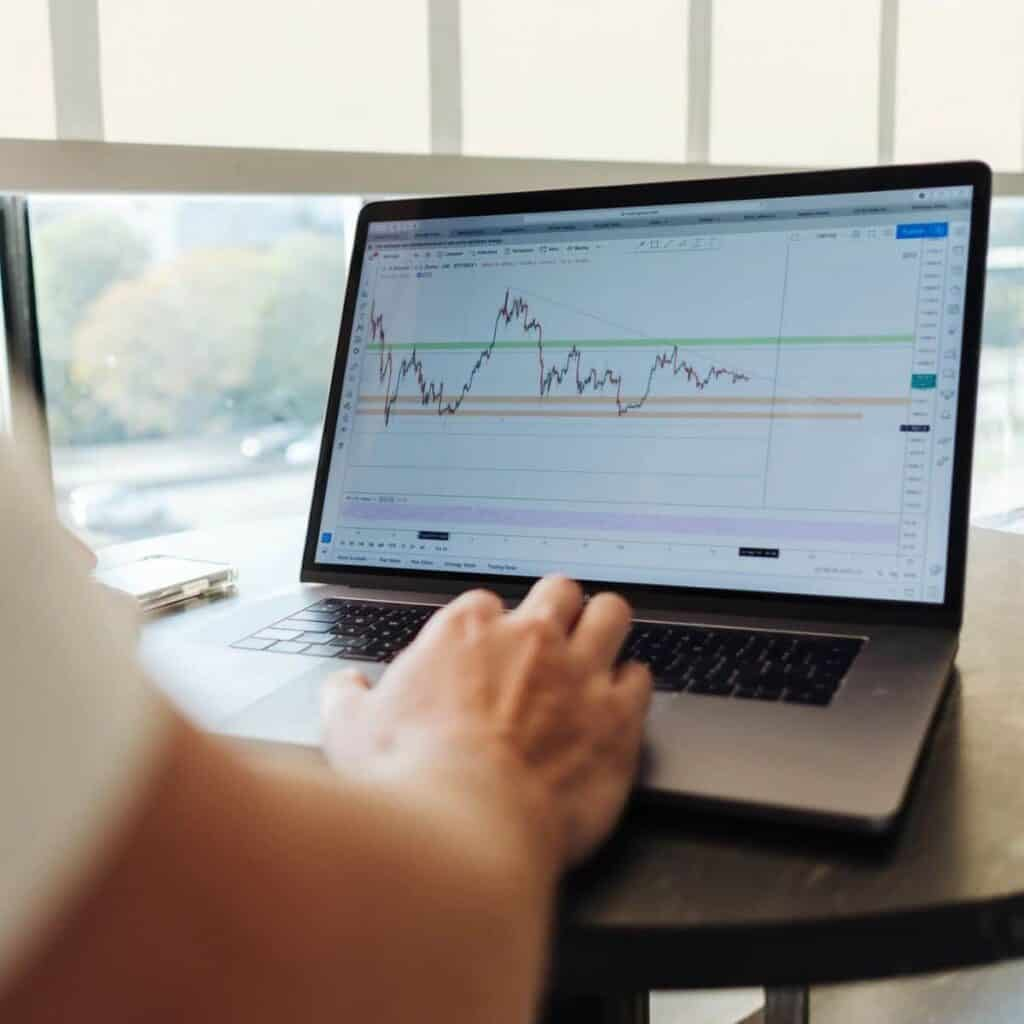 Person on a laptop showing a graph of a stock.