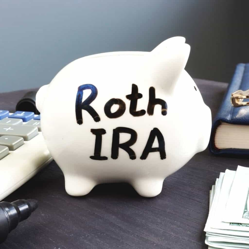 Roth IRA piggy bank on a table.